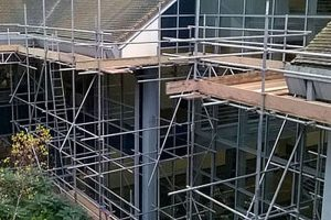 view of an office block with full scaffolding in place by Kingsley Scaffolding