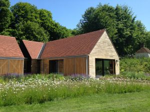 A building at the open air museum in Sussex recently completed by Kingsley Roofing in red tiles on a pitched roof