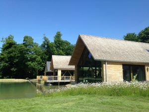 Handmade sweet chestnut roof shakes installed by Kingsley Roofing at the open air museum in Chichester, Sussex.