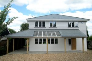 Residential property refurbishment in Bognor Regis with roof completed in grey-green Brazilian slates by Kingsley Roofing.