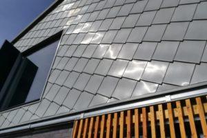 Zinc detail shingle cladding